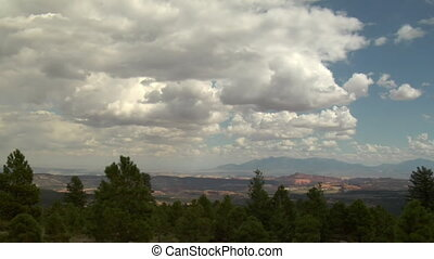why the Vista of trees, clouds, and natural Bridges national...