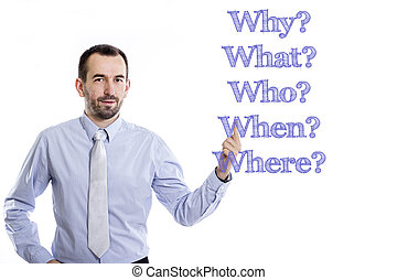 Why? What? Who? When? Where? - Young businessman with small beard pointing up in blue shirt