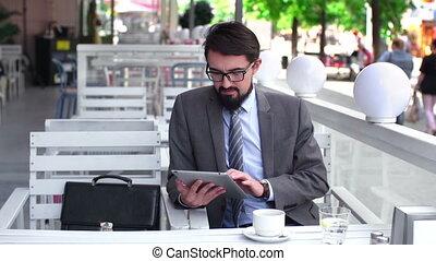Wi-Fi Cafe - Man in formalwear swiping digital pc in cafe