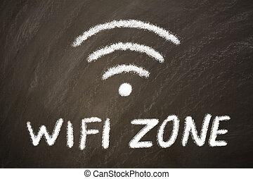 Wi-Fi zone sign written on a black board