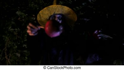 Wicked Witch show enchanted apple in Halloween Horror Scene...