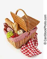 Wicker basket filled with a summer picnic