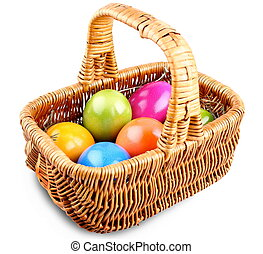 Wicker basket full of colorful Easter eggs
