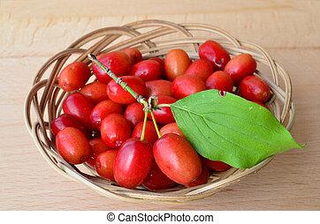 Wicker basket full of Cornelian cherries