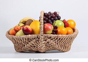 Wicker basket full of fresh fruit
