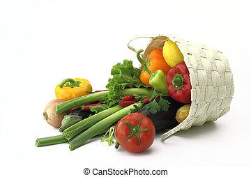 Wicker basket full of fresh vegetables