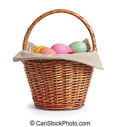 wicker basket full of pastel colors easter eggs