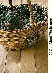 Wicker basket full of wine grapes
