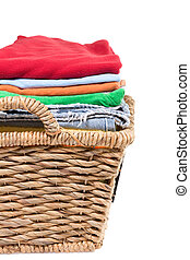 Wicker basket of clean fresh laundry filled with neatly ...
