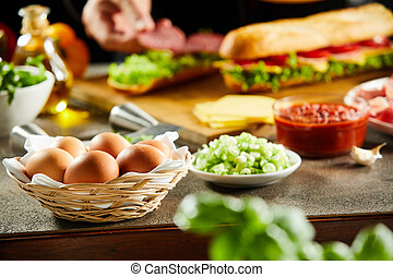 Wicker basket of fresh eggs on a kitchen counter
