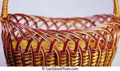 Wicker basket - Rotating Vinewoven empty basket on a light...