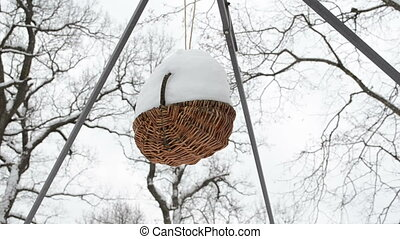 wicker basket snow winter - Closeup wicker basket hang cover...