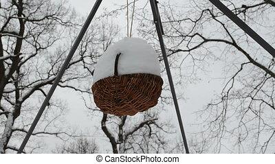 wicker basket snow winter - closeup wicker basket hang...