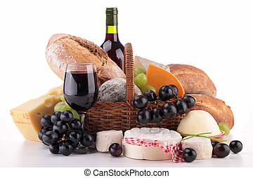 wicker basket with bread, cheese and wine