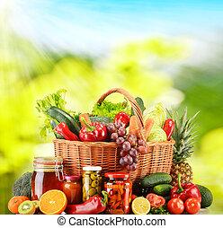 Wicker basket with fresh organic vegetables. Balanced diet
