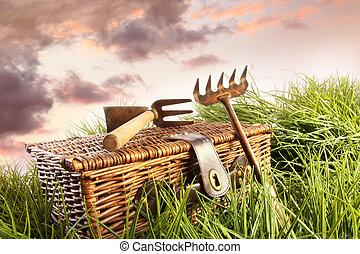 Wicker basket with garden tools