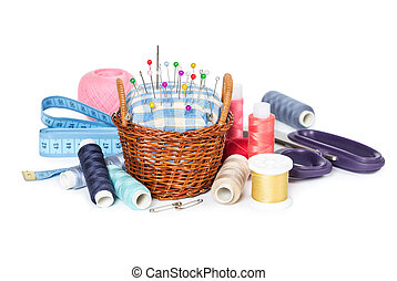 Wicker basket with pincushion and accessories isolated on white background
