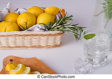 Wicker basket with rosemary and lemons.