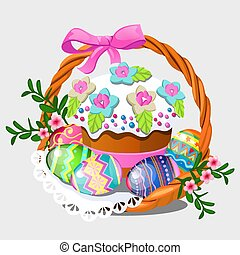 Wicker basket with set of colorful eastern eggs, flowers and...