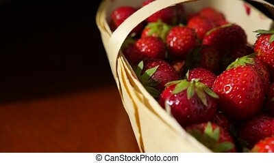 Wicker basket with strawberry on the table, close-up 4k,...