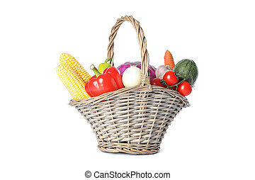Wicker basket with vegetables isolated on white background