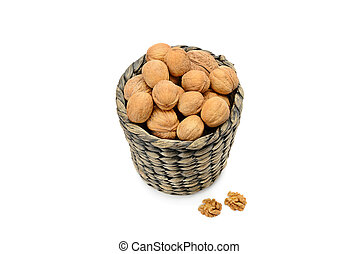 Wicker basket with walnuts isolated on a white background.