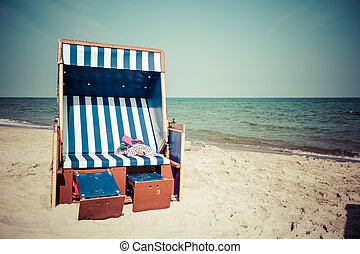 Wicker chairs on Jurata beach on sunny summer day, Hel peninsula, Baltic Sea, Poland