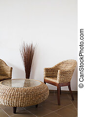 Wicker furniture - Wicker table and chairs against a white ...