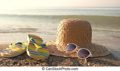 Wicker hat on the shore.