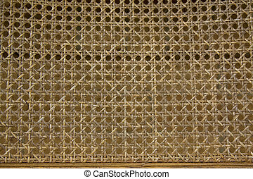 Wicker Pattern - Old, weathered, wicker chair back for...