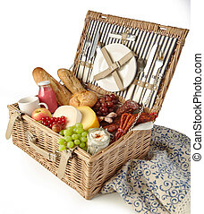 Wicker picnic hamper with assorted fresh food