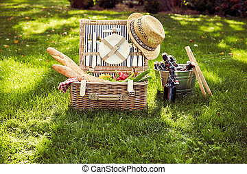 Wicker picnic hamper with vegetarian food