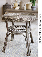wicker stool in oriental vintage style closeup indoor photo...