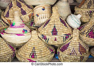 Wicker Tajines in the market, Morocco