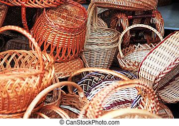 Wickerwork baskets of different sizes, a big heap