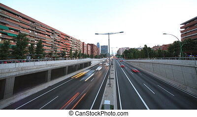 wide-angle panning timelapse evening traffic shot from a bridge in barcelona spain