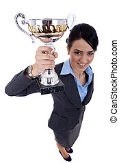 business woman winning a cup - wide angle picture of an ...