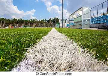 shot from marking line of soccer field at sunny day
