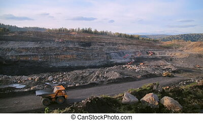 Wide-angle shot of an empty dump truck rides - The wide-...