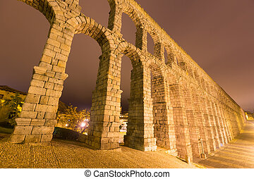 wide angle shot of antique roman aqueduct