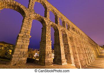 antique roman aqueduct in evening. Segovia, Spain