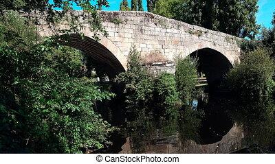 Allariz roman bridge - Wide angle static camera view of...