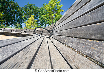 Wide Angle View Curving Row of Benches - Wide angle shot of...