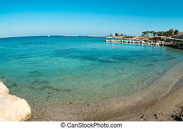 Wide angle view of empty sandy beach in Cyprus, Mediterranean sea