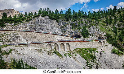 Falzarego pass curve with tunnel