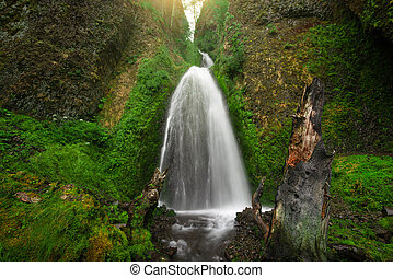 Wide angle view of Wahkeena Falls at the Columbia River Gorge in Oregon