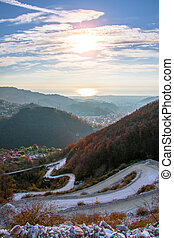 Wide angle view of winding road, laid to the top of the mountain.