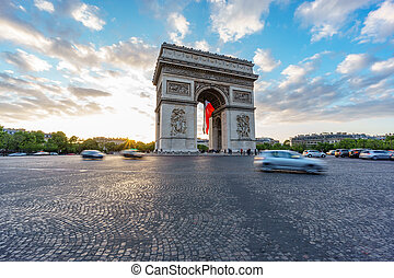 Wide Arc de Triomphe and blurred traffic at sunset