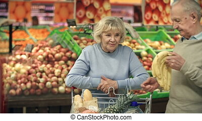 Wide Choice - Close up of elderly woman standing in...