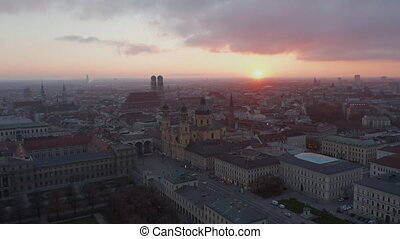 Wide Establishing Shot above Empty Munich, Germany Due to Coronavirus Covid 19 Pandemic Lockdown, No People and No Traffic on German Streets, Aerial View at Sunset 4K